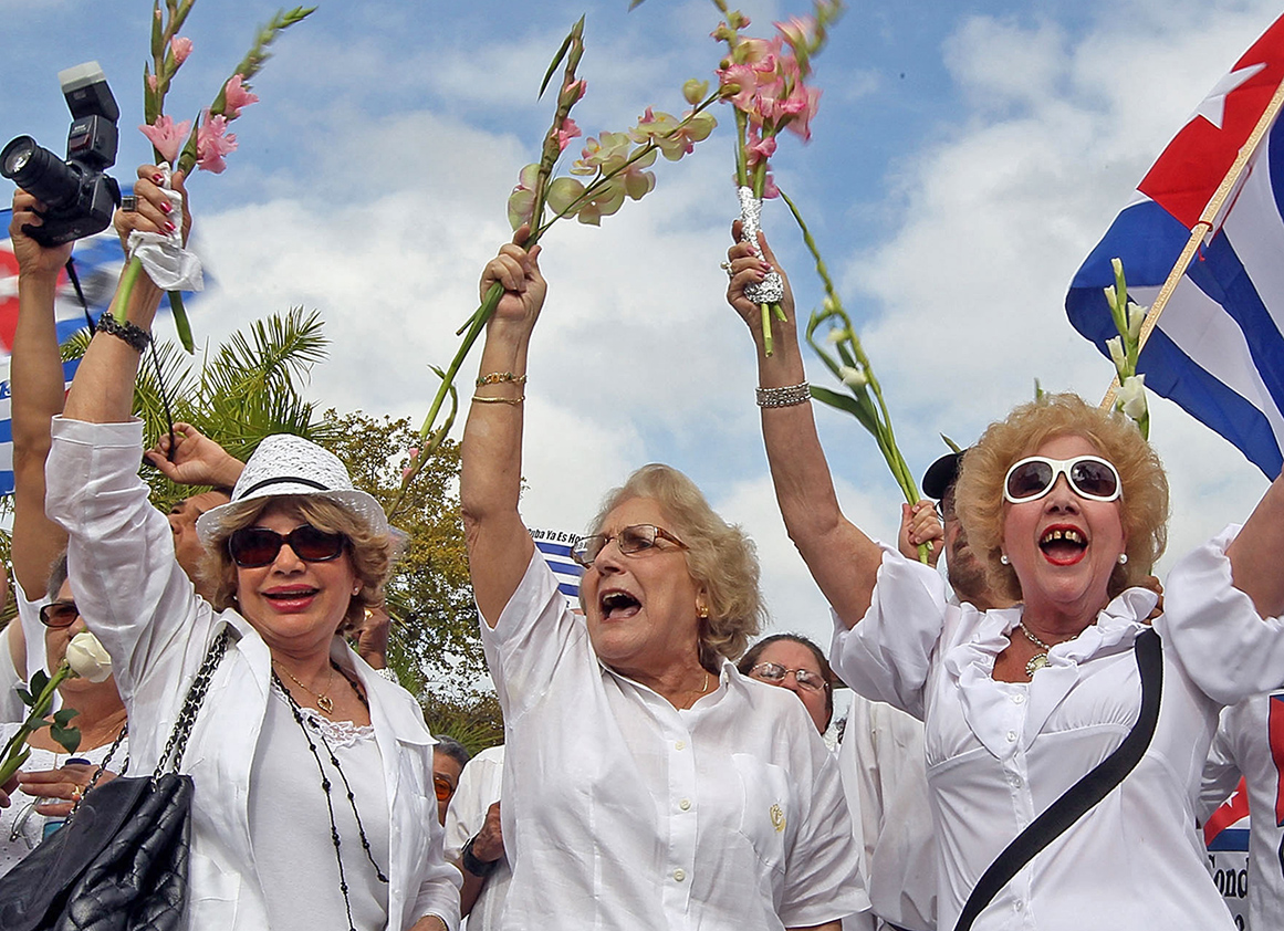 MIAMI - MARCH 25: People show their support for Cuba's Las Damas de Blanco on March 25, 2010 in Miami, Florida. In Cuba last week the Las Damas de Blanco, Ladies in White, who are peaceful dissidents, were attacked by government security forces in Havana.   Joe Raedle/Getty Images/AFP